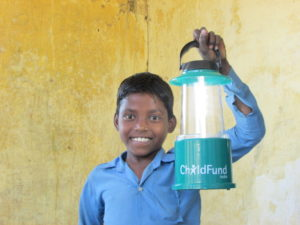 boy holding green lantern light lamp