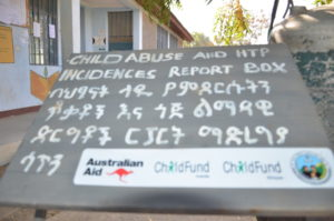 A sign for a child abuse reporting box in Ethiopia.