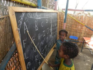 Children learn the alphabet while participating in the Community Caring for Children Program in Ethiopia.
