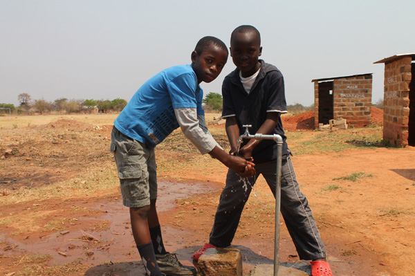 children at a water point put by ChildFund