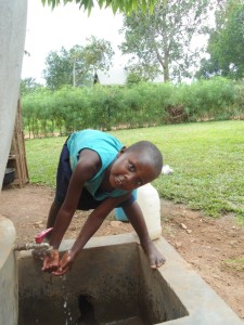 A smile on scovia's face, being able to access water at the door step