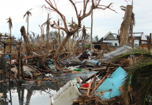 Destrcution of infrastructure including homes, trees, flooding from Typhoon Haiyan's aftermath