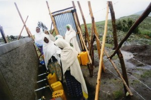 Women from both villages come to collect clean, fresh water from the newly erected fresh water spring