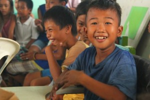 Children displaced by typhoon Haiyan enjoy art, games and festive birthday noodles at ChildFund's Child-Centered Spaces