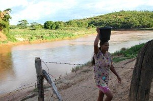 Claudia collecting water from the local river. Photo courtesy of P&G.