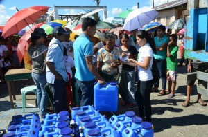 ChildFund staff and volunteers distributed jerry cans with water filters installed.