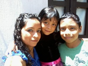 Rosy and her two children Andrea Isabel and Julio Fernando.