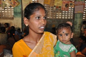 Saraswathi and her baby at a parenting workshop in southern India.