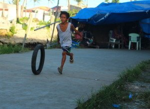 In Tacloban, children are playing again, even though signs of the typhoon's destruction remain.