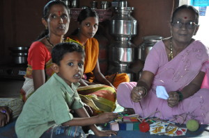 Anita Ghalekar monitors a boy's growth in his home in the Raigad district.