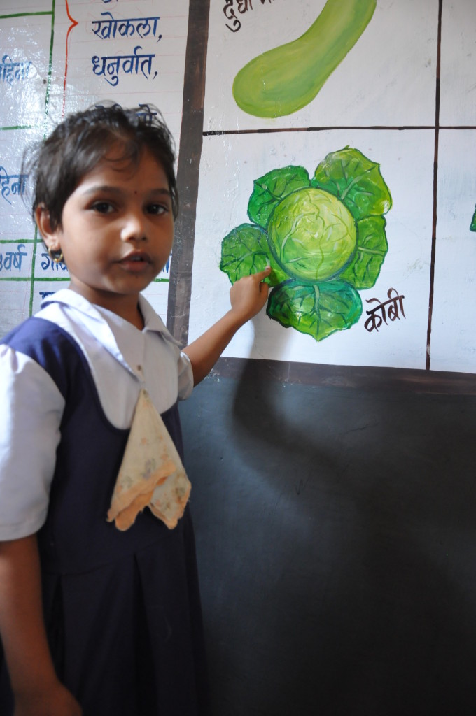 Four-year-old Vaishnavi showing a cabbage art at an ECD centre in Raigad district of India's Maharashtra State.
