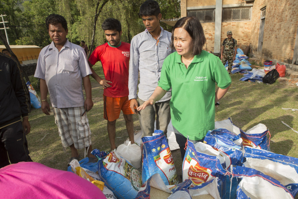 ChildFund's Aileen Santiago distributing aid in Sindhupalchok District  - Jake Lyell