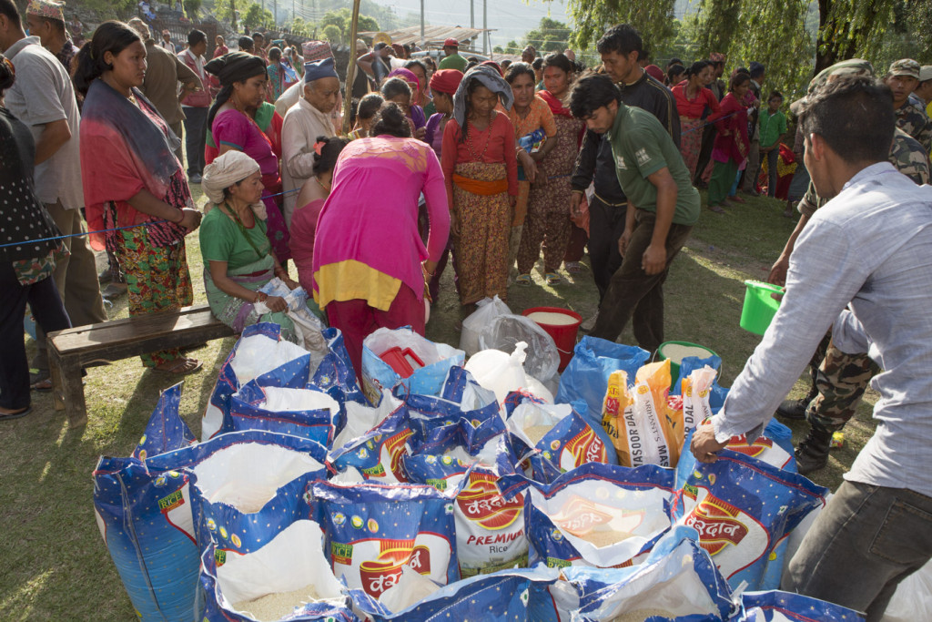 Families in Pangretar village receiving emergency food supplies from ChildFund [Credit: Jake Lyell/ChildFund]