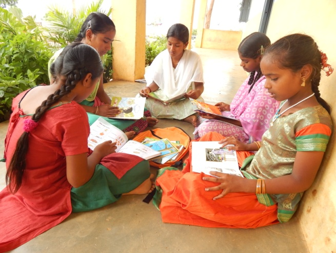 14 yrs old Pooja from a village in southern State of Andhra Pradesh, India, enjoying story books given by ChildFund India under its Books, my Friends Campaign