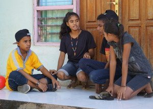 "Abay, 14, (second from left), who plays a mother in the drama, explains positive discipline during drama rehearsal. ""I'm happy because the drama we presented was wonderful. I can use it in my life and share what I have learnt with other people."" Use of physical punishment is common in Timor-Leste's classrooms- a 2014 government survey found 67% of children have received corporal punishment in schools. The Children Against Violence use drama, art and other visual arts to raise awareness of the governments 'zero tolerance' policy against corporal punishment and promote child rights."