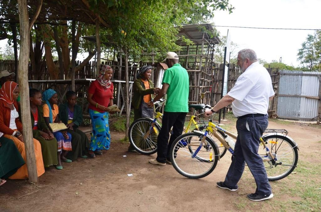 ChildFund Ethiopia Country Director Chege Ngugi and ChildFund Ireland CEO Michael Kiely presenting 'Dream Bikes' to school girls near Ropi, Ethiopia April 2016