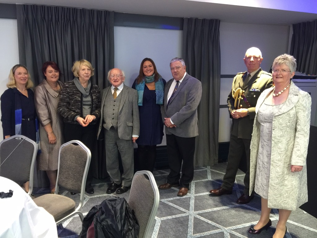 Camogie Association President Catherine Neary and CEO Joan O'Flynn pose with Meg Gardinier, Mick Kiely & Elena Lorigan of ChildFund, along with Uachtarán na hÉireann Michael D Higgins, his wife Sabrina, and ADC.
