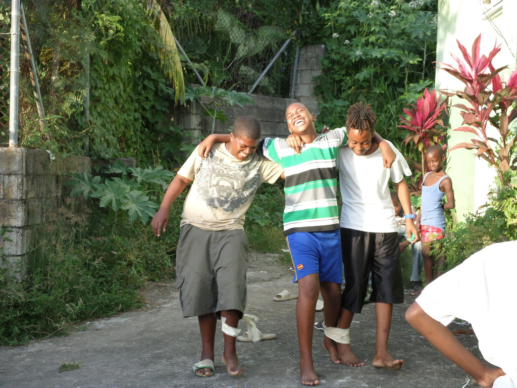 Participants on the Shine a Light programme in Dominica enjoy a game of three-legged running. Games are used to lighten the tone and enable facilitators to engage with participants