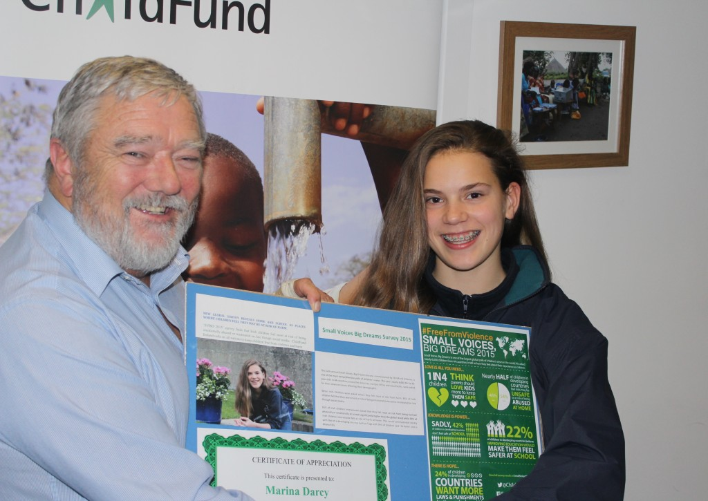 Marina being Presented with a Certificate of Appreciation by ChildFund E.O. Michael Kiely