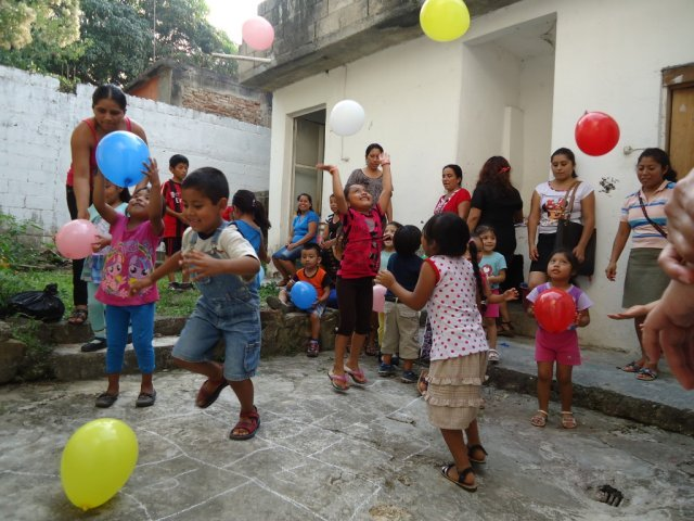 Children play with balloons at ChildFund local partner Sakubel in Chiapas, Mexico. tag = group playing running throwing balloon balloons color colors colorful