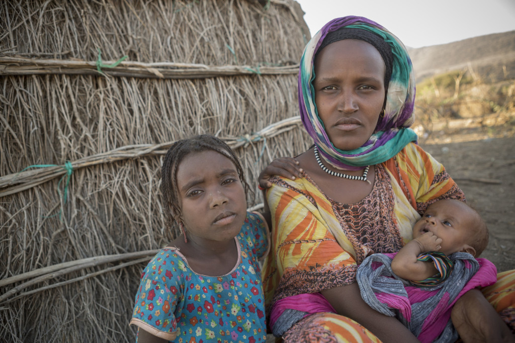 Halko, 28, sits outside her home with her daughter Meti, 7 and her three-month-old son Fentale, who has been diagnosed with Severe Acute Malnutrition.