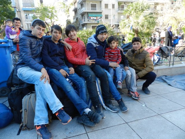Caption: In central Athens, Victoria Square is inundated with migrants from Afghanistan, Syria and Iraq waiting to board buses to the Macedonian border.