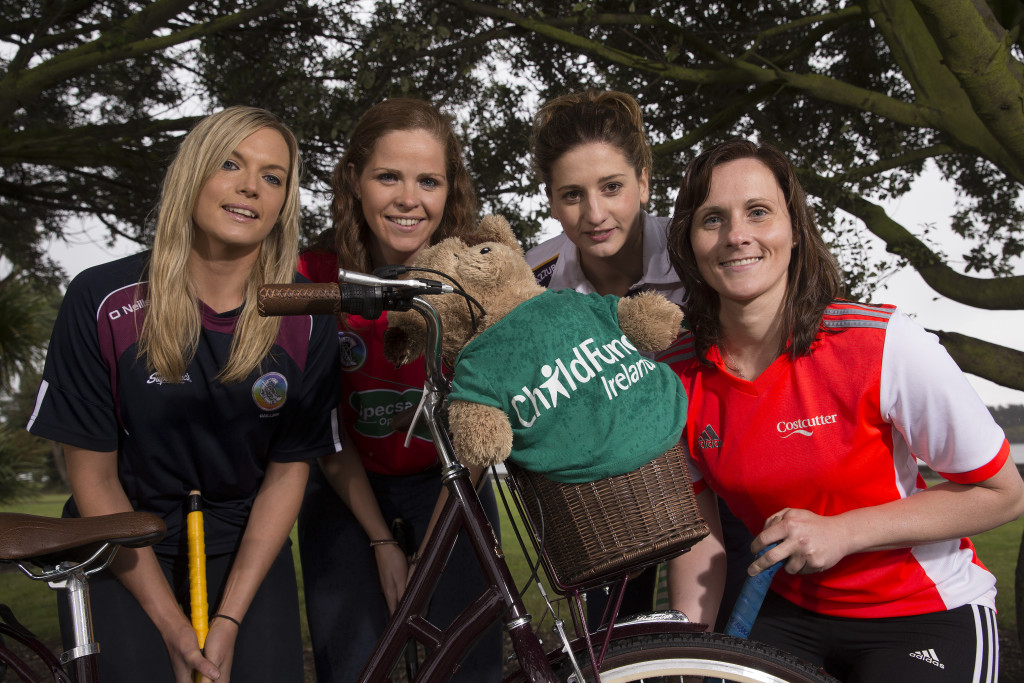 REPRO FREE Camogie Association & ChildFund Ireland Partnership Launch, Clontarf, Dublin 26/8/2015 Camogie stars on their bikes for ChildFund: Pictured (L-R) at the announcement that the Camogie Association are partnering with ChildFund Ireland was Sarah Dervan from Galway, Fionnuala Carr from Down, Mags D'Arcy from Wexford and Aoife Murray from Cork. The Camogie Association and ChildFund Ireland will be partnering on a number of key initiatives over a two year period, in particular the Dream Bikes project whereby Camogie clubs and individuals will work to raise funds to donate to ChildFund in order to purchase bikes for school going children in the countries in which ChildFund Ireland works. Mandatory Credit ©INPHO/Billy Stickland