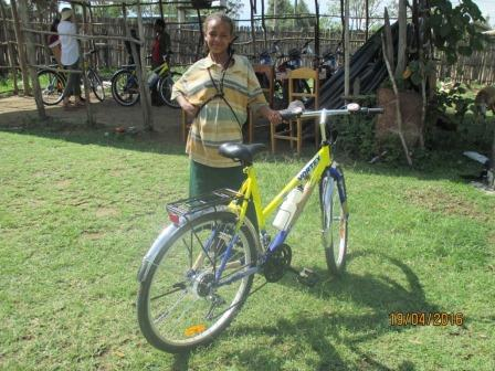 A girl from Siraro District, Ethiopia proudly displays her new 'Dream Bike'