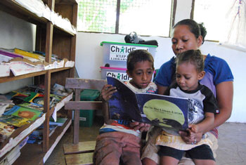 Rince and her 9-year-old son, Jimmy, participated in a family literacy program in Biqueli, Atauro Island. Now, they spend time each day together reading and visit the school library at least once a week.