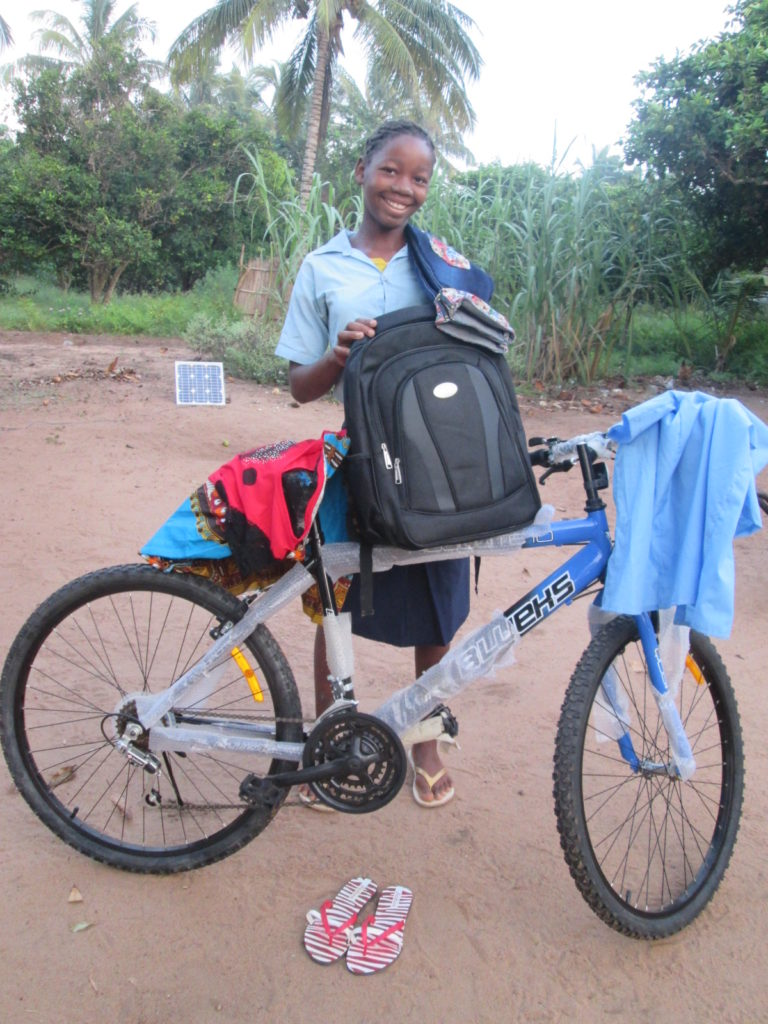 Sizina proudly shows off the bike that will hugely assist her in being able to get to school regularly