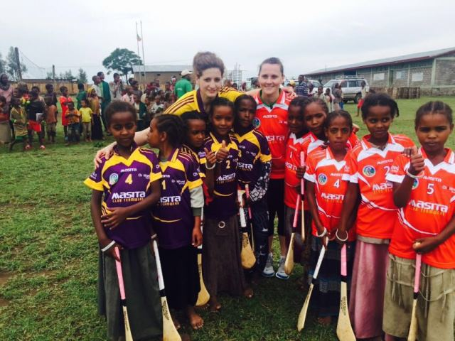 Mags and Aoife pose with local girls ahead of Africa's first ever camogie game: Ropi, Ethiopia: April 2016