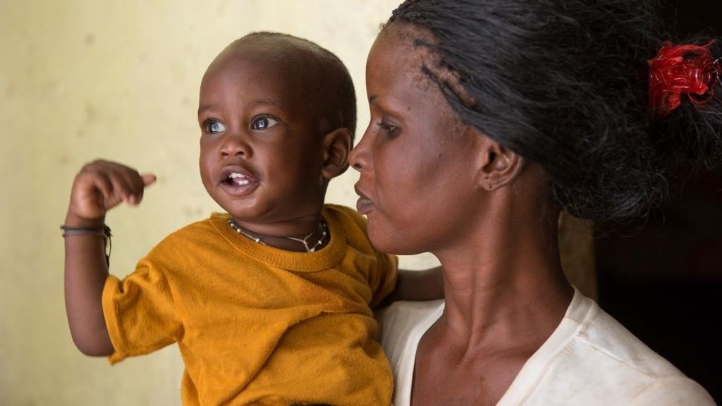 Awa Thian holds her 12-month-old son, Ndiaga, at their home in M'bour, Senegal. When community health volunteers identified Ndiaga as malnourished, he and his mother participated in a 10-day nutrition and recovery workshop that enabled him to gain weight.  Senegal.November 8, 2013.Photo by Jake Lyell