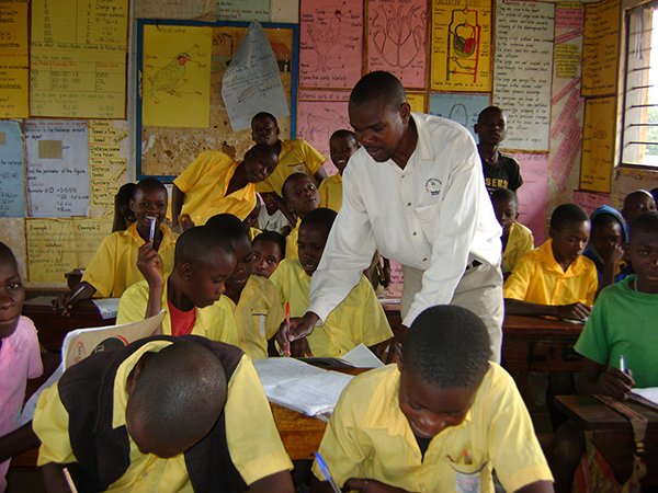 Paul Mudhasi, a former sponsored child in Uganda, now teaches in the primary school he attended as a child.