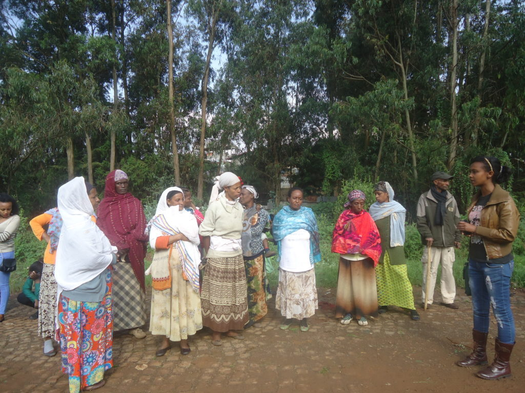 A health extension worker talks to community members about sanitation and hygiene in Gulele, Ethiopia
