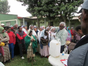 Gulele community members learn how to purify water so it is safe to drink and use for washing