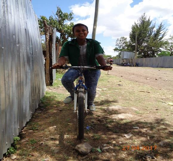 Rahel riding her bicycle to school